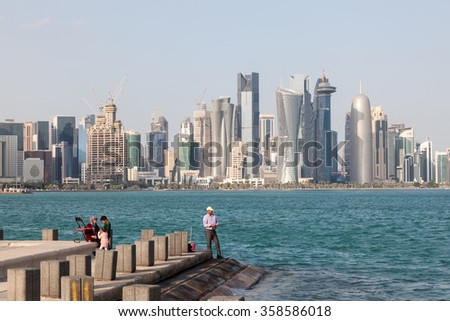 DOHA, QATAR - NOV 21: Hobby fisherman with his family fishing at the corniche of Doha. November 21, 2015 in Doha, Qatar, Middle East