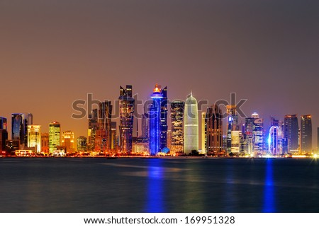 DOHA, QATAR - NOV 14: Iconic new towers grace the skyline of the West Bay area of Doha at dusk on Nov 14, 2013 in Doha, Qatar. The West Bay is considered as one of the most prominent districts of Doha - stock photo