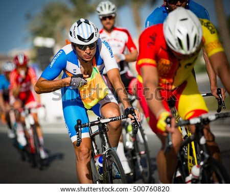 Doha, Qatar - October 16, 2016: Cyclists pass through the feed zone during the elite men's road race at the UCI Road World Championships.