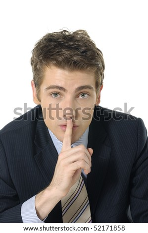doing a silence gesture with his forefinger - stock photo