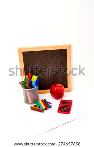 Doing homework with crayons and calculator - stock photo