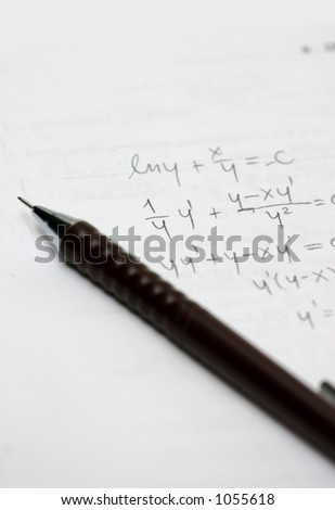 Doing mathematical calculations. - stock photo