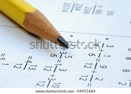 Doing some grade school Math with a pencil - stock photo