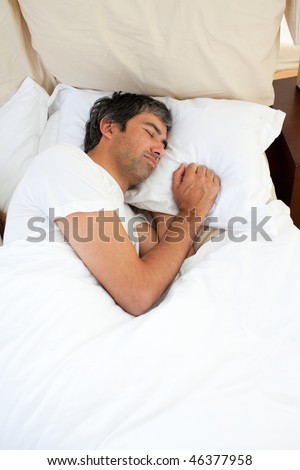 Doleful man sleeping after having an argument - stock photo