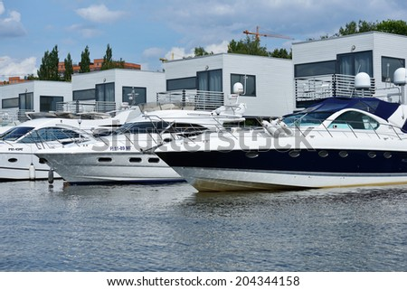 DOLGOPRUDNY, MOSCOW REGION, RUSSIA - JULY 4, 2014: Boats moored in the yacht club Neptune. Founded in 1998, now the club have modern quay side for mooring over 100 vessels