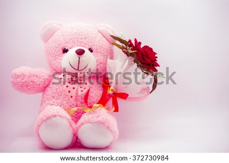 Doll bear pink with red rose. Valentine day. style vintage pink - stock photo