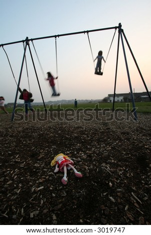 Doll in swing park - stock photo