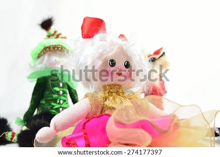 doll with friends over white in store