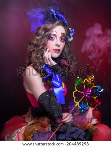 Doll. Young woman in bright holiday image. - stock photo