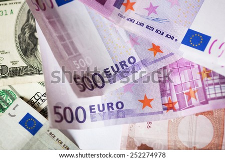 dollar and euro notes.good background for business concept. - stock photo