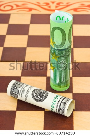 Dollar and euro on chess board - business concept background - stock photo