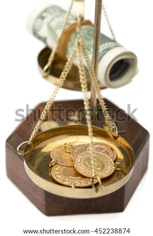 Dollar and Gold Balance Close up    - stock photo