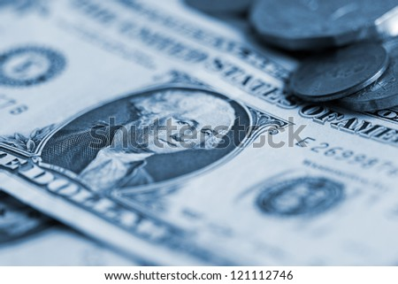 dollar banknote and coin close up
