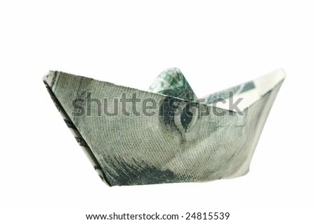 dollar banknote folded as a ship, business concept. Clipping path included - stock photo