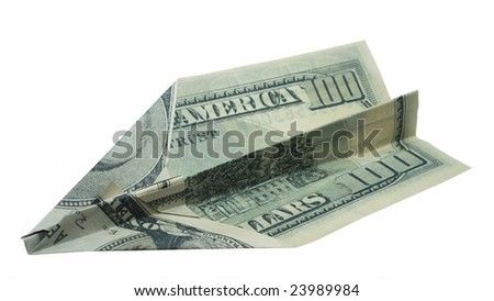 dollar banknote folded as an airplane, business concept