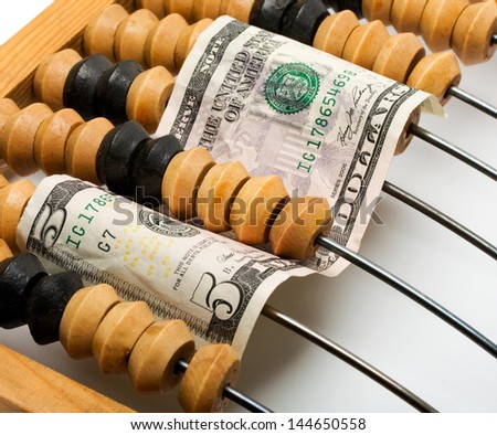 dollar banknote in wooden abacus and concept isolated on white background - stock photo