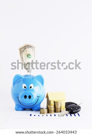 Dollar banknote into piggy bank and coins with car keys for Saving money concept
