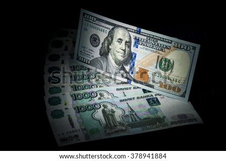 Dollar banknote on russian rubles banknotes. Financial theme. Exchange rate.