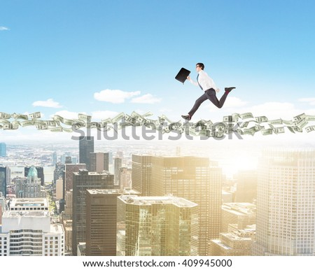 Dollar banknote path with running businessman above sunlit New York city - stock photo