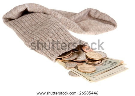 Dollar banknotes and coins in an old grey sock - stock photo