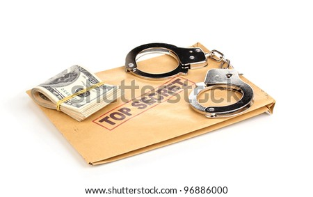 Dollar banknotes and handcuffs on top secret envelope isolated on white - stock photo