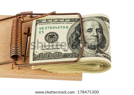 dollar banknotes in a mousetrap. symbolic photo for debt - stock photo
