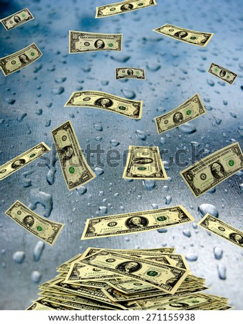 dollar banknotes lying on the wet glass with drops - stock photo
