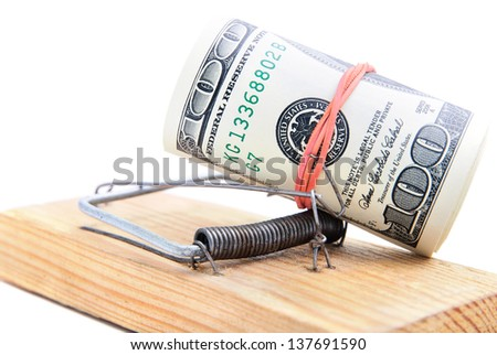 dollar banknotes roll in a mousetrap as concept of money security or bait - stock photo
