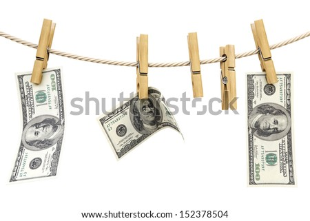 dollar bill is hanging on a rope with wooden clothespin. isolated on white.