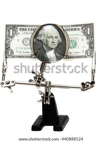 Dollar bill Vodin on a special holder with magnifying glass isolated on white background - stock photo