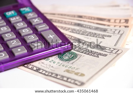 Dollar bills and calculator