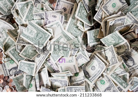 Dollar bills and coins - stock photo
