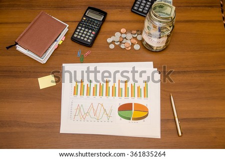 Dollar bills and graphs for finance concept - stock photo