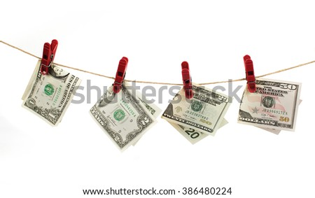 Dollar bills hanging on a rope with wooden pegs isolated on white - stock photo