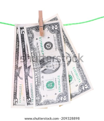 Dollar bills hanging on rope attached with clothes pins. Money-laundering concept. Isolated on white background. - stock photo