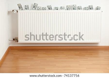 dollar bills inside a white radiator - stock photo