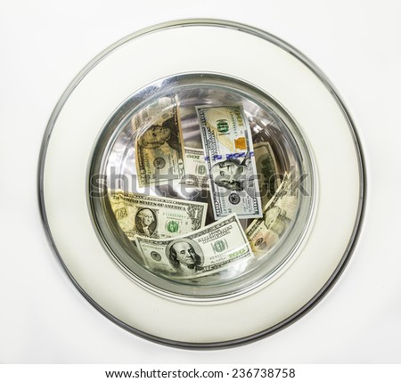 Dollar bills is washed in the washing machine drum - stock photo