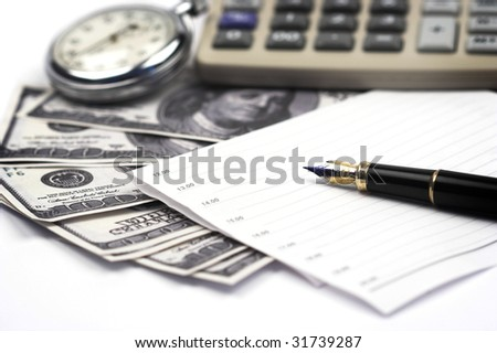 Dollar bills,pen and calculator close up - stock photo