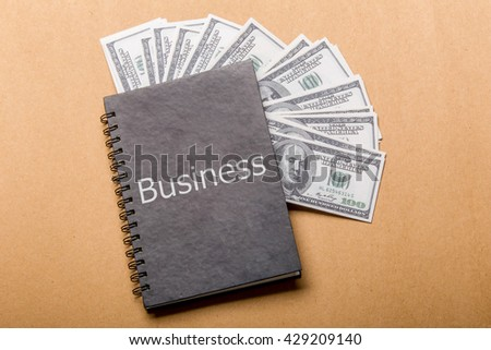 """dollar book and word """"Business"""" on cover - stock photo"""