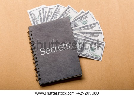 """dollar book and word """"Secrets"""" on cover - stock photo"""