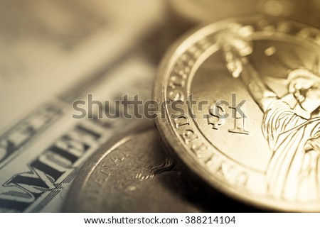 dollar coins and dollar banknotes for finance and banking concept background - stock photo
