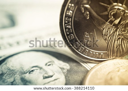 dollar coins and dollar banknotes for finance and banking concept background
