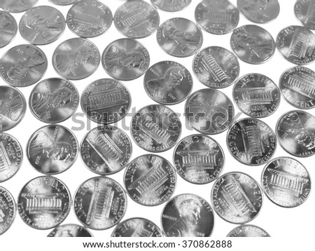 Dollar coins 1 cent wheat penny cent currency of the United States in black and white - stock photo