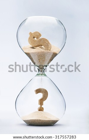 Dollar crisis. Question mark made out of falling sand from dollar sign flowing through hourglass