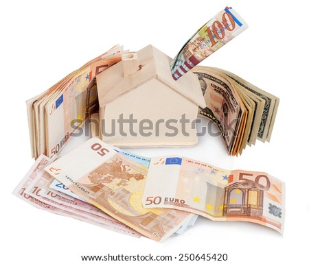 dollar ,euro, shekels  and a wooden house model - stock photo