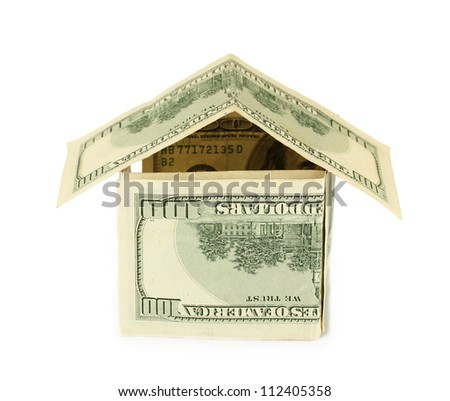 Dollar house isolated on white background close-up