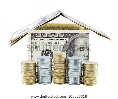 Dollar house with gold and silver coins isolated on white background. Concept - stock photo