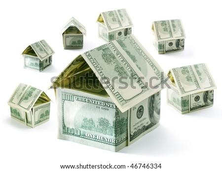 Dollar houses isolated over white - stock photo