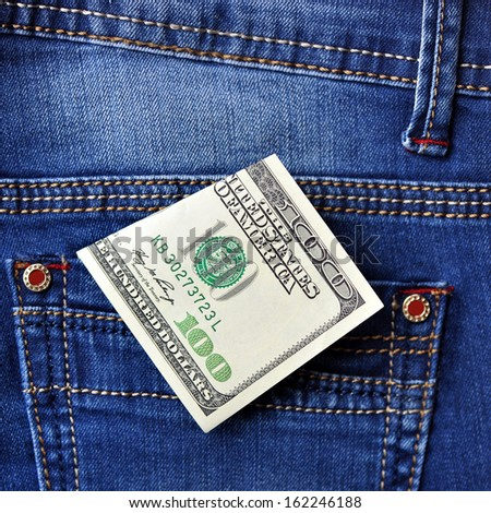 Dollar in a jeans pocket