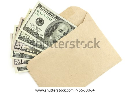 Dollar money banknotes on envelope isolated on white - stock photo